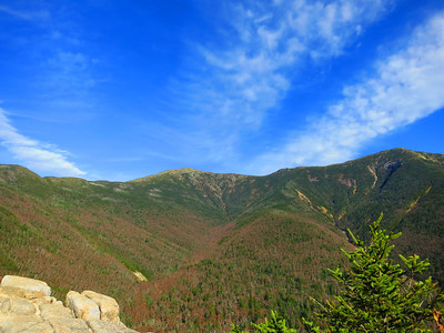 OK - that's Mt Lafayette left of middle, though from this angle it appears lower than Mt Lincoln on the right.