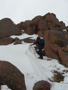 Still in snowshoes, but not for long as we were thrust into 3rd class rock.   [Summit out of sight.]