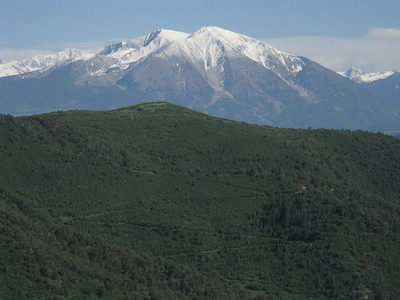 This telephoto shot of Mt Sopris was taken from the Iron Mt adventure park above Glenwood Springs on June 15, 2010 (while returning from a trip to Utah). Yes - it is twin-summitted with both the west and east summits officially identical: 12,593.