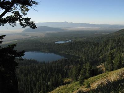 View to SE: Bradley Lake near, Taggart Lake farther.