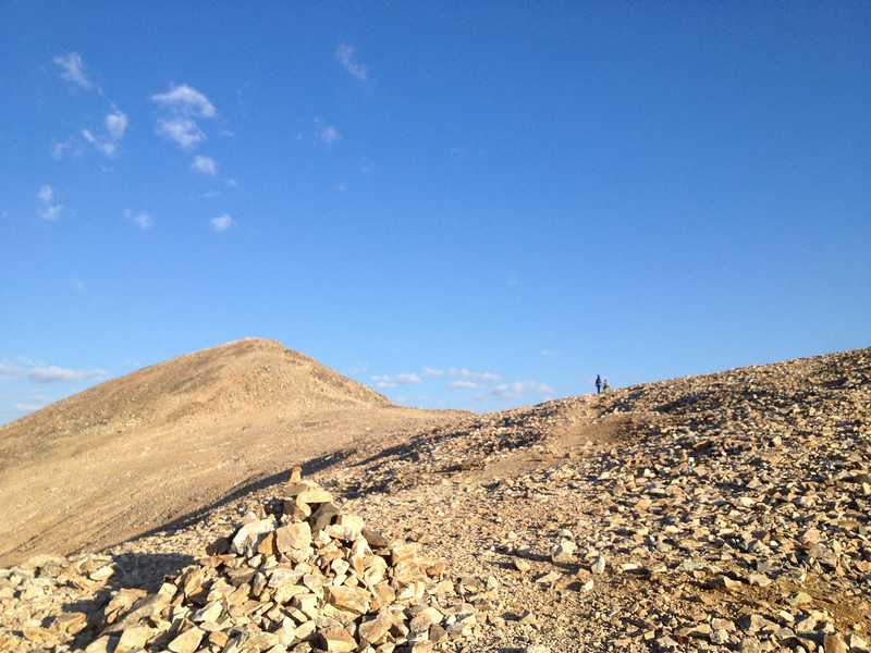 Follow the ridge west and ascend switchbacks - true summit just out of view.