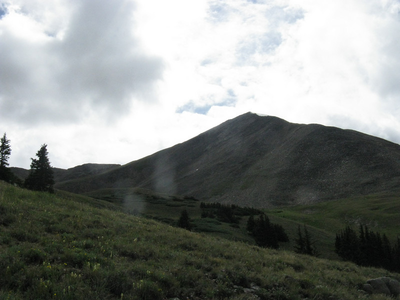 Close to treeline now and our first full view of Huron. Trail will ascend up the foreground meadow, then along the ridge left of the summit.