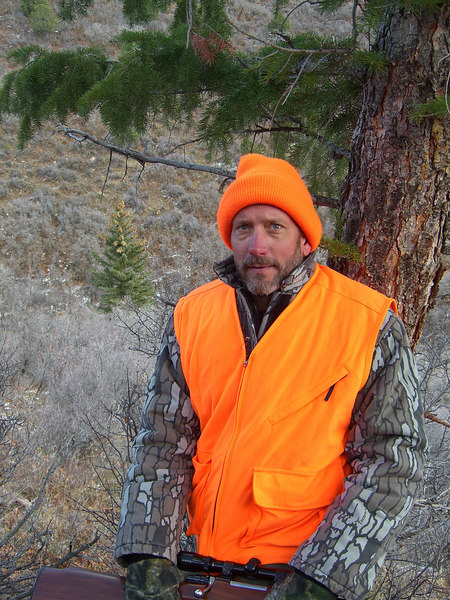 Does it make sense to wear camo and orange?? Ya don't wanta argue with this gnarly dude!