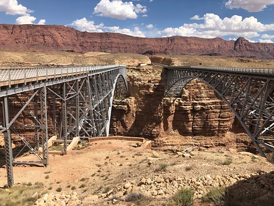 Navajo Bridge (old left for walking; new right for cars) - your last chance to drive over the Colorado River until  Hoover Dam, 342 miles downstream. .. Weblink below: