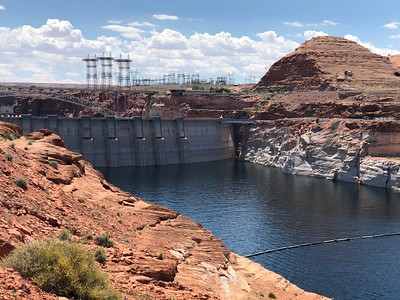 Whew - Glen Canyon Dam is still holding back Lake Powell. .. All systems go. .. River flow, of course, is determined by what the dam releases.  .. Since the dam's completion in 1963, there are no natural spring floods - mega-bummer.  .. Weblink below: