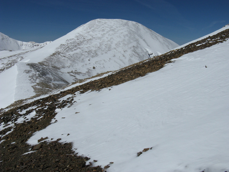 View of ridge to the south - and Mt Sheridan. .. I'm hitting the ridge well above the saddle.