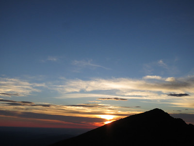 Here comes the sun from behind Mt Lady Washington - yeah, God.
