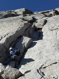 Climber following; belayer above (naturally).
