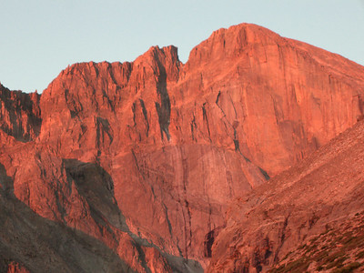 The East (Diamond) face of Longs is kissed at sunrise. [The prominent notch to the left of the summit is The Notch.]