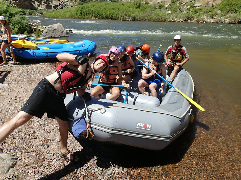 """Yeah, it's all """"fun and games"""" - until we get serious! You know this is a private trip rather than commercial due to the variety of helmet colors among the seven paddlers."""