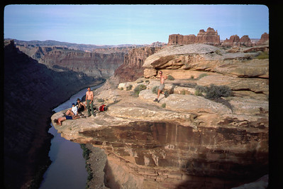 Our last full day - now overlooking the Colorado River, as Bill races the timer to get in the scene. .. Our canoe trip ended at the confluence of the Green with the Colorado. .. We were then jet-boated back up the Colorado to near Moab.