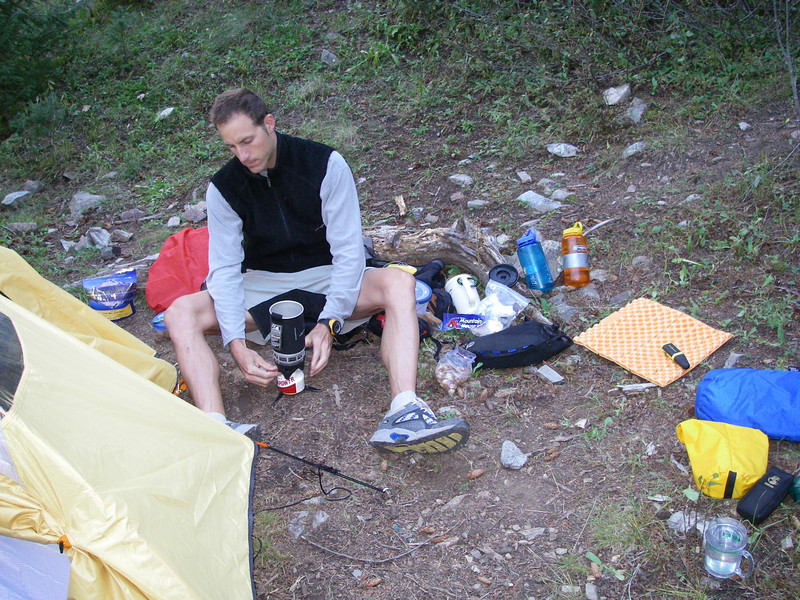 At last, time for a sumptuous freeze-dried dinner. Brett is a nationally-ranked Adventure Racer - meaning he's in way-serious good shape. .. He'll climb in those shoes and shorts - no matter the weather.