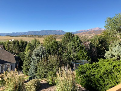 OK, Saturday morning - from my deck the view of the Ute Valley Park ridge - the line across the center; Pikes Peak on right.