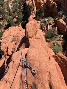 This is a five-bolt, single-pitch route - 2nd or third bolt here. .. Kevin seen belaying below.