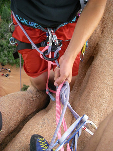 Rigged for Ben's rappel. [Notice the crowd of admirers below.  Mid-west tourists eat this up.  They always think we have giant suction cups on our soles, which we rarely do.]