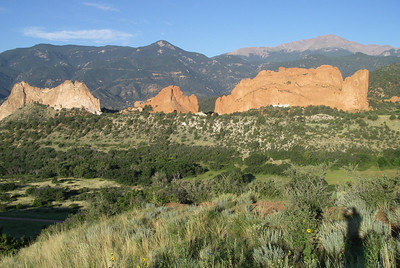 The principal formations at Garden of the Gods from the east, Pikes Peak in the background. L-R: Grey Rock, South Gateway Rock and North Gateway Rock with Kissing Camels on top.