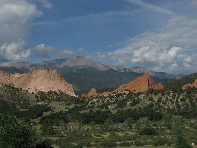 Later than morning, 8/25, terrace at Garden of the Gods Visitor Center, to get climbing permit. Note Montezuma's Tower as the lower formation in center of shot.