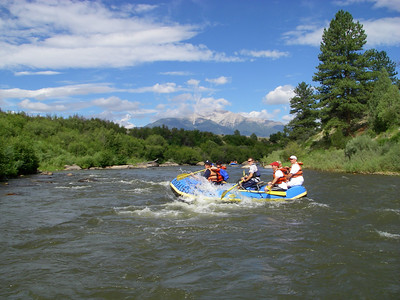 "This was the other boat in our pod.  [Did you know dolphins travel in pods?] Mt. Princeton in the background. [Note: this wimpy ""combo"" boat has an oarsman in addition to the paddlers.]"