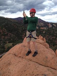 Chris shooting video or panorama. .. Blodgett Peak in distance behind him.