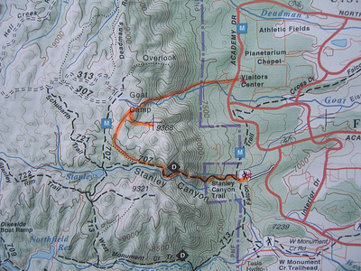 Our CCW loop marked in Orange.  Up Goat Camp Creek on trail, then up NW slope to summit of 9368 (aka Eagle Pk).  Then cross-country, unintentionally missing Stanley Reservoir, and down and out Stanley Cyn.  Car shuttle had been set up between the two trailheads. Total hiking distance: 6-7 miles.