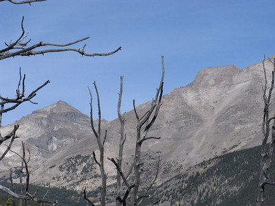 "[Telephoto]: The ""flat top"" of Longs is evident behind Meeker. Pagoda Mtn on the left."