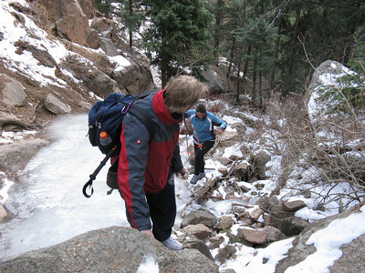 Making our way past the crux (read very icy) section. Ice has overflown onto the trail on the left.