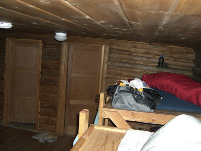 There are nine cabins with a total of 62 bunks.  If you arrive later in the day, expect to get an upper bunk!  Cost is $12 per person per night - $8 for AAC members, which I am. Brett is still in his bag here.  [Well, I am too!]