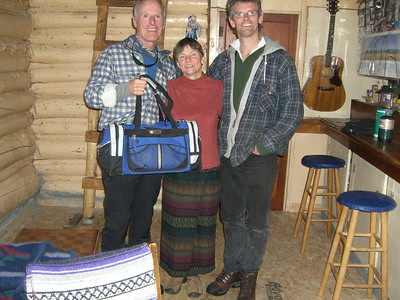 "Bill and the Barr Camp caretakers: Therese and Neal Taylor. I'm holding ""the duffle bag"" left by ""Joe,"" the dude whose life Neal saved late at night earlier in the week. The Taylors celebrated their 25th Anniversary in Sept (years of marriage - not years as caretakers, which have been about 1.5)."