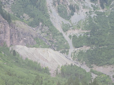 That's our trailhead, just to the right of the mound of mining debris, with a couple of white cars there.