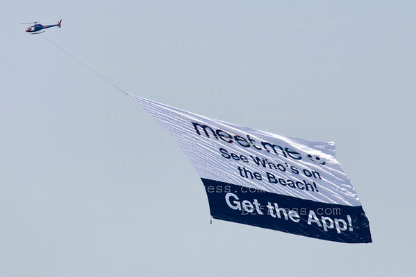 "Expensive in gas advertising from an helicopter for an App  "" MeetMe "" in Malibu,California"