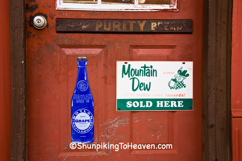 Advertising for Purity Bread, Boylan Soda, and Mountain Dew on Door of General Store, Piatt County, Illinois