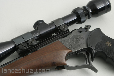 """Thompson Contender with .357 14"""" barrel and Tasco 3-9x40 scope."""