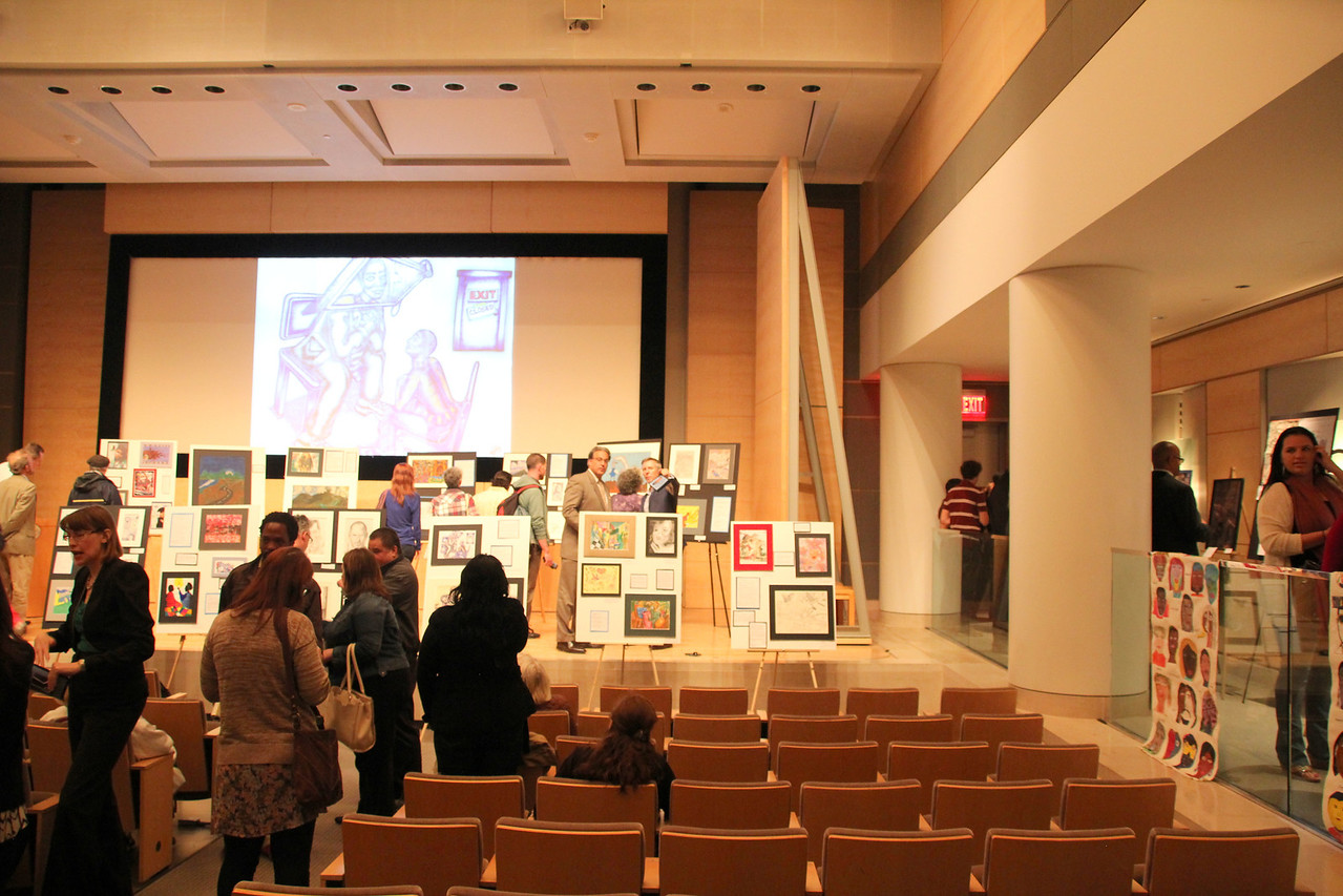 """The """"Breaking Down our Walls"""" show opens and people begin to gather."""