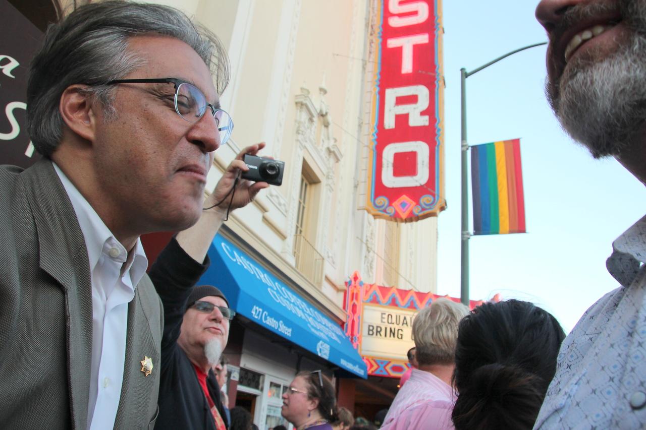 Left, San Francisco Sheriff Ross Mirkarimi, shares a laugh.