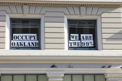 Window signs seen on Broadway near 14th Street, downtown Oakland, California.