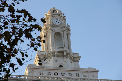 The clock tower on top of Oakland City Hall.