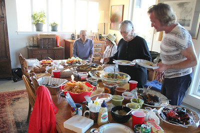 Gerry Crowley considers her choices among a very tasty spread of food.