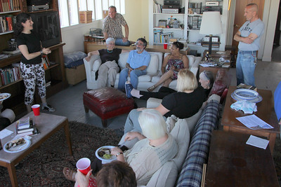 Daniela Kirshenbaum speaks, thanking Paul Wermer for all his past contributions.  Daniela Kirshenbaum addressing the group.  Couch closest to camera: Left to right: Marlayne Morgan, Kris Schaeffer, (unknown), Gerry Crowley.  Back couch, left to right: Judith, Aaron Peskin, Leah Taylor Pimentel,   Standing on right: Jim Meko.  NOTE►These photos look best if you maximize your browser window to full screen.