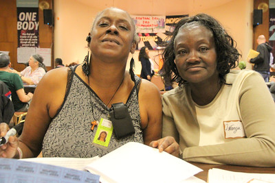 Signing in guests to convention, Left to right, Devonnie Walker, LaTonya Jones - Tenant Organizers at the Central City SRO Collaborative