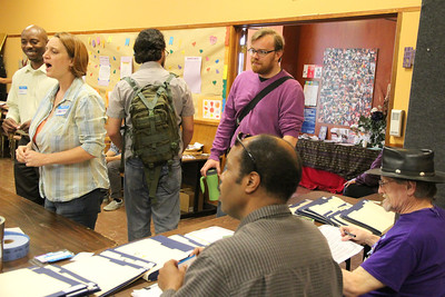 Guests signing in to the convention including Matthias Mormino, standing, right.
