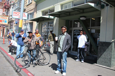 Darnell Boyd, Tenant Organizer stands in front along with his fellow Tenant Organizers who gather in front of the SRO Collaborative and assemble in preparation of marching to the Hall of Justice.  48 Turk Street, San Francisco, May 30th, 2013.