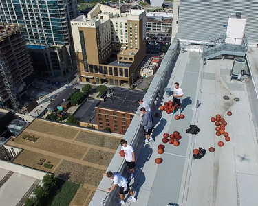 Roof crew with drone shadow