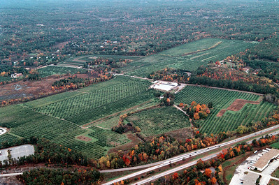 Reaching from the Park and ride at Exit 4 on 93 on the south side, (seen here on the bottom left) to the Spring Road area on the north, Woodmont Orchards consists of about 264 acres of fields and farm.  The buildings on the lower right are on the east side of Route 93, the bottom most building houses Phantom Fireworks today on Londonderry Road.