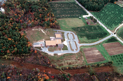 Moose Hill School tucked in behind the Moose Hill Orchard.  the rust colored area is the Tennesee Gas Pipeline that feeds the Granite Ridge Power Plant.  In the center, upper, right of the picture is the Morrison House Complex.  The barn is the Parmenter Barn, a print of this image in a large size shows the details of the historic site including the cellar hole and flax fields.