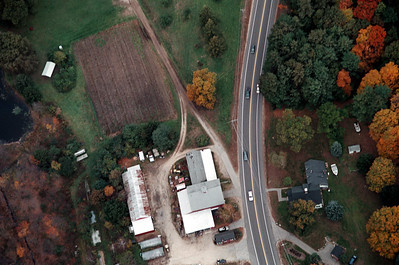 Looking down at the antique barn you can see the cupola at the center of the barn.  It has a bright gold horse weather vane on it.  Not many get to see behind the barn, this makes it easy.  The pond in the left center of the photo is a free picnic area, just ask.  The green tree near the pavilon near the pond is a willow and has a great swing.  Even the detail of the power lines will come out in your print.