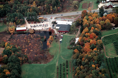 "So crowded on the weekends in the fall the cars park in back near the bunkhouse.  That is the white roof you see in the center right at the edge of the fall foliage.  The pond has ducks and geese that need to fly south in the winter!  The orchard on the highland to the right is accessed from U-Pick 3 and has a wonderful Gazibo.  On a clear day you can see Boston.  It is marked on maps and is the farms namesake ""Moose Hill."""