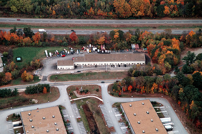 Londonderry Road, home to several office buildings some with garage units in the back of the buildings for light warehouse or repair.  To the left not shown are two fireworks stores and a self storage center.
