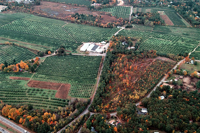 The Lievens Homestead can be seen on the left hand side, the red home framed with the bright yellow maple leaves.  These images were shot in the fall of 2005.  Just at the very top far left is the back corner of the Market Basket in Londonderry.  The white buildings with black rooftops are located on Commons Drive.  This first class office complex is nestled into the Woodmont farm.