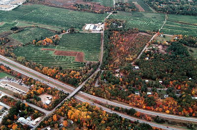 Route 93 borders the Woodmont Orchard on the east side south of Pillsbury road.  In the lower left is the intersection of Londonderry Road and Pillsbury Road.  The right hand side on the right near route 93 is Trolley Car Lane.  In the Upper left corner you can see Market Basket at the top and Sears Essentials on the left.