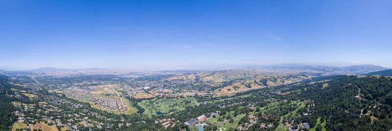 Panoramic Aerial Scenery. Far left is Stoneridge Mall & Dublin, CA. Center is Castlewood Country Club. Far right is Pleasanton Ridge Regional Park & Sunol, CA. Highway seen is Interstate 680. Augustin Bernal Park - Pleasanton, CA, USA